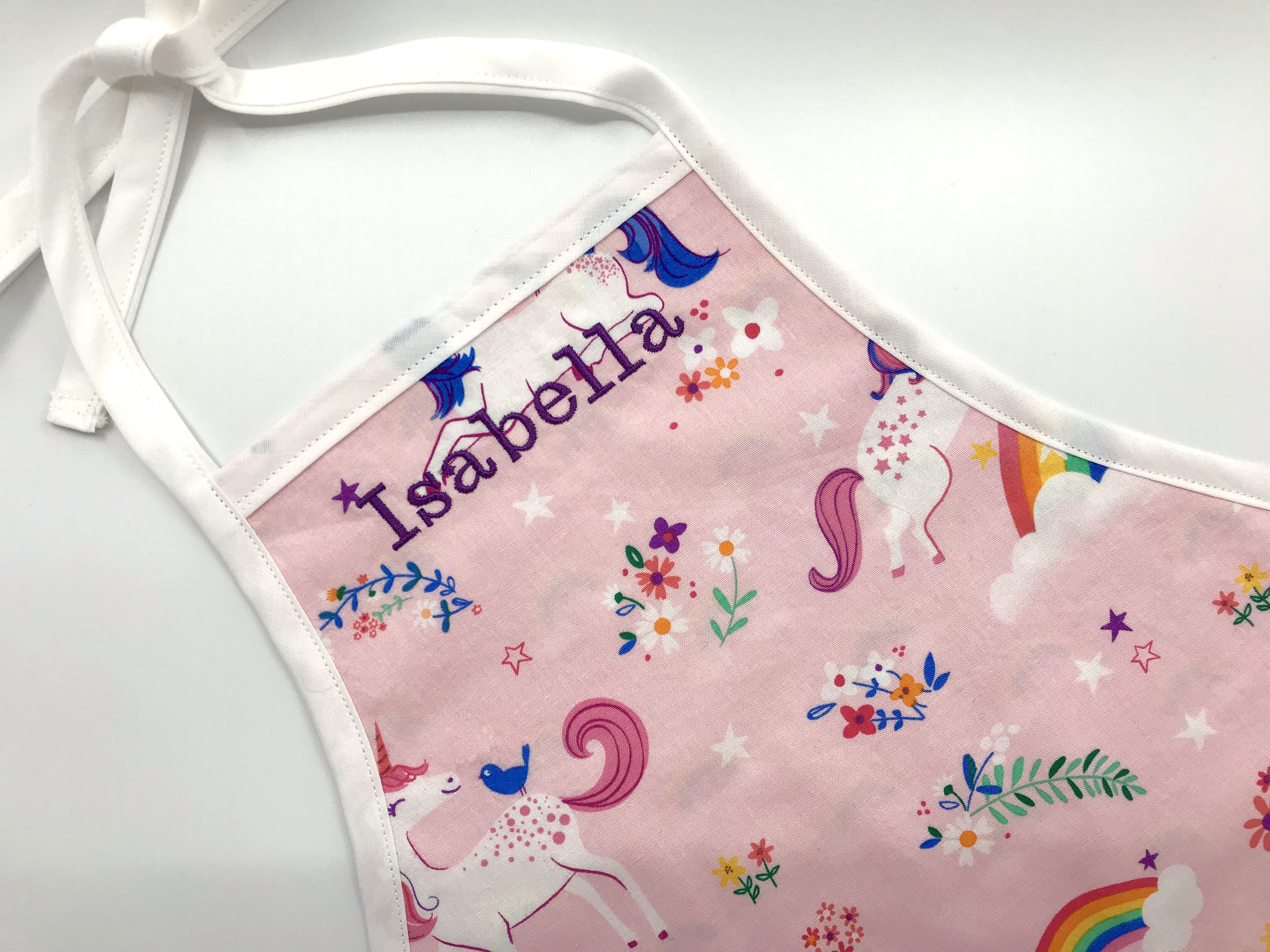 Pink unicorn apron with child's name. A personal gift for the holidays!